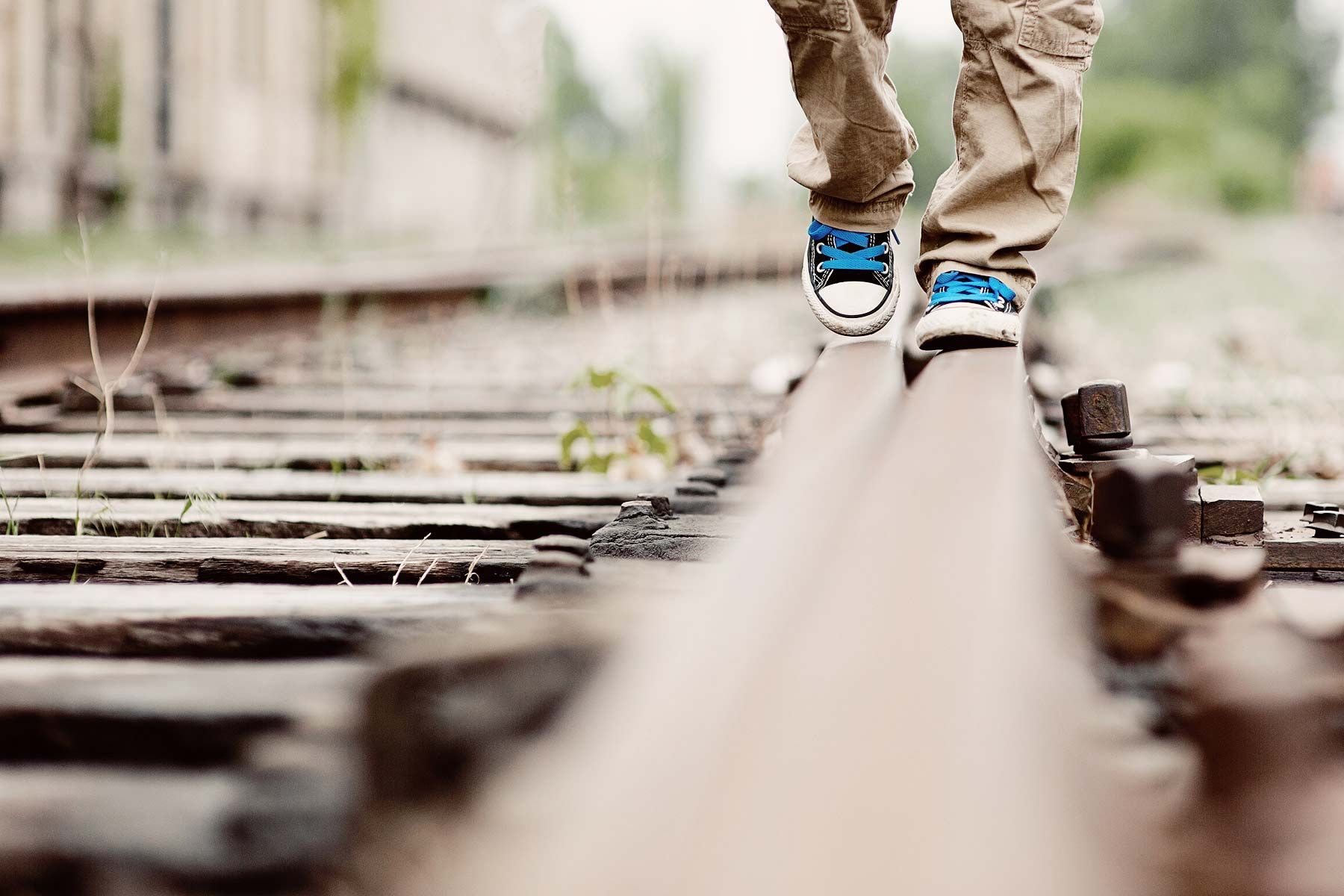 Childs Feet On Tracks